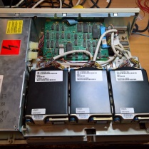 VAXstation 3100 With Cover Removed Viewed From Above Showing Top Drive Plate With 3 Drives